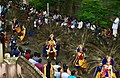 1st day procession with costumed Kartikeya deity riding peacock at the Hindu festival Onam in Kerala.jpg