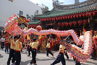 Dragon dance - Performers holding the dragons on poles in Taiwan
