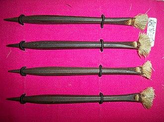 Shuriken - Four antique forged Japanese bo shuriken (iron throwing darts with linen flights)