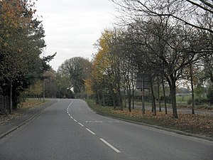 A535 road - A535 approaching Chorley Hall heading south. The approaching left road is Chorley Lane.