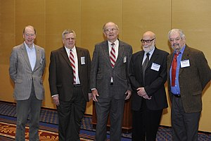 Higgs mechanism - Five of the six 2010 APS Sakurai Prize Winners – (L to R) Tom Kibble, Gerald Guralnik, Carl Richard Hagen, François Englert, and Robert Brout