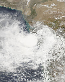 A satellite image of Deep Depression ARB 02 located just off the Gujarati coast shortly before landfall on 23 June