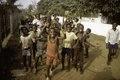 ASC Leiden - F. van der Kraaij Collection - 01 - 035 - Waving boys in front of a long low white wall - Monrovia, Old Road, Montserrado County, Liberia, 1977.tiff