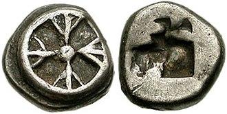 Hippias (tyrant) - Coinage of Athens at the time of Hippias. Four-spoked wheel / Incuse square, divided diagonally. Circa 545-510 BC