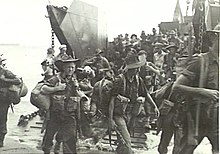 Soldiers disembarking from a landing craft