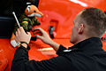 A NATO officer places his air crew's mascot on a Coast Guard helicopter 140603-G-XX113-095.jpg