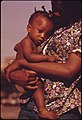 A South Side Chicago Ghetto Mother And Child Who Live In Nearby Low Income Housing, 06-1973 (8674917083).jpg