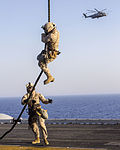 A U.S. Marine assigned to Battalion Landing Team, 3rd Battalion, 2nd Marine Regiment, 26th Marine Expeditionary Unit (MEU) fast ropes from a CH-53E Super Stallion helicopter assigned to Marine Medium Tiltrotor 130630-M-SO289-022.jpg