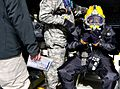 A diver, right, assigned to the 511th Dive Detachment, Special Troops Battalion, 7th Sustainment Brigade, makes his final inspections before his dive into the York River during a training exercise off the 130308-A-ZZ999-760.jpg