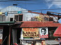A sign supporting Filipino boxer Manny Pacquiao in the city of Tacloban, which was devastated by Typhoon Haiyan (11290258395).jpg