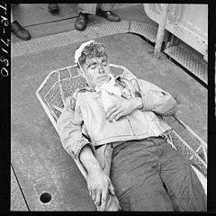 Aircrewman, wounded during raid on Rabaul, on board the USS Saratoga (CV-3). Alva Parker (ARM1) who suffered shrapnel... - NARA - 520891.jpg