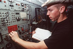 Airman 1st Class Kevin Finley, satellite communications specialist, 5th Combat Communications Group, Robins AFB, GA, checks the power level of a high power amp F3201-SPT-94-J3001-94-080.jpg