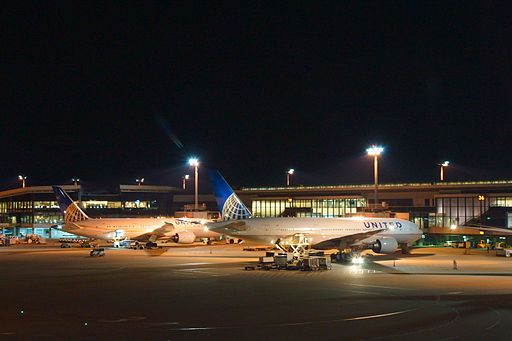 Airplanes of United Airlines in tarmac at Narita Airport apron at night.