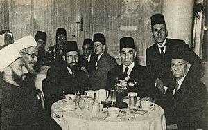 Hassan al-Banna - Al-Banna (third from left) with Aziz Ali al-Misri (fourth from right) and Egyptian, Palestinian and Algerian political and religious figures at a reception in Cairo, 1947