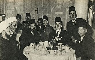 Hassan al-Banna - Al-Banna (third from left) with Aziz Ali al-Misri (fourth from right), Mohamed Ali Eltaher (second from the right) and Egyptian, Palestinian and Algerian political and religious figures at a reception in Cairo, 1947
