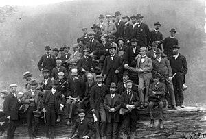 Geological Society of America - Geological field excursion to Harpers Ferry, West Virginia, April 30, 1897, following the George Huntington Williams Memorial Lectures delivered by Sir Archibald Geikie at Johns Hopkins University. The photograph was taken by Joseph S. Diller at Jefferson Rock, above Harpers Ferry.  Individuals in photo include (starting at top):  Cleophas C. O'Harra, Sir Archibald Geikie, Frederick H. Newell, Henry B. Kümmel, George Burbank Shattuck, Rollin D. Salisbury, Arthur Clifford Veatch, Louis Marcus Prindle, Harry F. Reid, Charles R. Van Hise, Cleveland Abbe, Jr., George Willis Stose, Thomas Leonard Watson, Edward Vincent D'Invilliers, Clarence Wilbur Dorsey, Frederick J.H. Merrill, Louis A. Bauer, Arthur Coe Spencer, William J. McGee, William B. Clark, Rufus Mather Bagg, Frank Hall Knowlton, Robert T. Hill, Heinrich Ries, Frank D. Adams, Arthur P. Coleman, Timothy William Stanton, Oliver L. Fassig, Samuel F. Emmons, George F. Becker, Albert Berthold Hoen, George O. Smith, James F. Kemp, Bailey Willis, David White, Edward Bennett Mathews, Charles D. Walcott, John W. Powell, Joseph Stanley-Brown, Joseph Austin Holmes, Charles Willard Hayes, Leonidas Chalmers Glenn, Henry S. Williams.