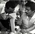 Andres Carrasco, CEDEN Laboratory Technician, Shows a Parasite to a Villager, Honduras, 1981 (13875629233).jpg