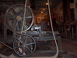 Territorial Enterprise - Antique printing press powered by flat-belt, overhead line shaft, at the Mark Twain Museum at the Territorial Enterprise, Virginia City, NV