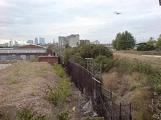 Silvertown Quays - View looking west from Silvertown towards the Millennium Mills and over the proposed site of Silvertown Quays. A British Aerospace 146 can be seen approaching London City Airport