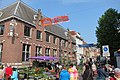 Arnhem Dudok Restaurant at Kings street, with flowermarket on friday before Kings day festivities - panoramio.jpg