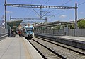 Attica 06-13 SKA train stop 03 Proastiakos train arriving.jpg