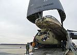 Australian Army CH-47F Chinook partially inside a USAF C-5 Galaxy at Dover Air Force Base.jpg