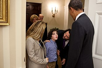Billy Mann - President Barack Obama greets Jasper Mann and his parents, Billy and Gena Mann, before signing the Combating Autism Reauthorization Act of 2011 in the Oval Office