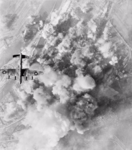 Avro Lancaster of No. 300 Polish Bomber Squadron flying over the smoke-covered target area in Bremen.png