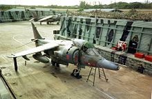 A Harrier stored at an airfield