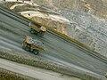 Batu Hijau mine ore trucks.jpg