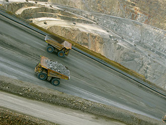Economy of Indonesia - Ore trucks in the mining area in West Sumbawa, NTB.