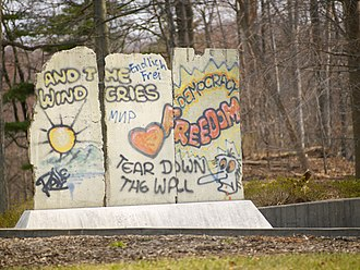 Optimism - Berlin Wall Monument (west view). The west side of the wall is covered with graffiti that reflects hope and optimism.