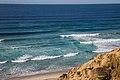 Black's Beach Surfer (16036510202).jpg