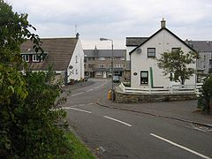 A road junction with houses either side