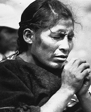 Religion in Bolivia - Aymara woman praying