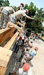 Bond beam work at Gabriela Mistral School construction site 150622-F-LP903-610.jpg
