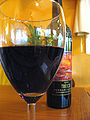 Bottle & glass of red Bordeaux style blend.jpg