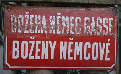 A street named after Bozena Nemcova with her name declined in the genitive case (a sign probably from the time of the Protectorate). Bozeny Nemcove Revnice 6258.JPG