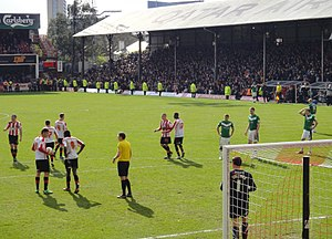 2012–13 Brentford F.C. season - Marcello Trotta (with the ball) prepares to take the injury time penalty kick versus Doncaster Rovers at Griffin Park.