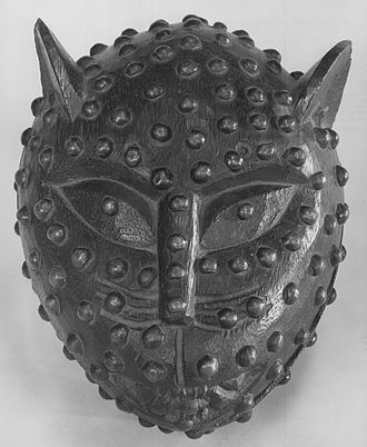 Animal epithet - Leopard's Head box, 19th century. Wood with metal tags, used to hold kola nuts in the royal court of Benin, where the leopard was an epithet for a powerful person.