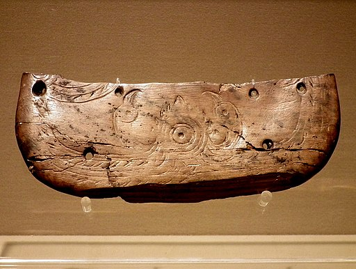 Butterfly-shaped ivory vessel with the pattern of two birds facing the sun(Neolithic) in Zhejiang Museum