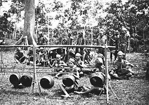 Dayak Mualang - The Mualang Dayaks perform with musical instruments during the visit of Governor General Johan Paul van Limburg Stirum, circa 1920.