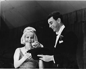 Charles Knox Robinson - Charles Knox Robinson demonstrating his skill as a magician, with the assistance of his wife Joan, at a late 1960s–early 1970s fundraiser.