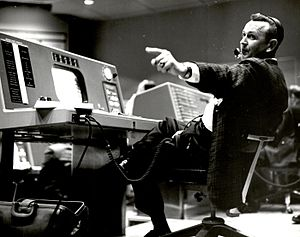 Christopher C. Kraft Jr. - Kraft works at his console inside the Flight Control area of the Mercury Control Center