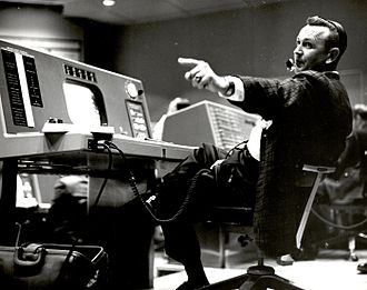 Christopher C. Kraft Jr. - Kraft works at his console inside the Flight Control area of the Mercury Control Center.