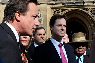 Public school (United Kingdom) - 2009 photograph of UK Leader of the Opposition and future Prime Minister David Cameron (left), Lib Dem spokesman and future Secretary of State for Energy and Climate Change Chris Huhne (centre) and Lib Dem leader and future Deputy Prime Minister Nick Clegg (centre right), all of whom had attended English public schools.