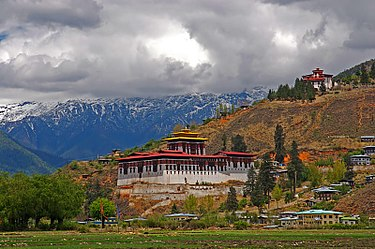 The dzong in the Paro valley, built in 1646. Cloud-hidden, whereabouts unknown (Paro, Bhutan).jpg