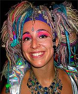 Raver with multi-colored, woolen and synthetic dreadlocks