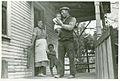 Coal miner, his wife and two children, (notice the child's l... (3109741441).jpg