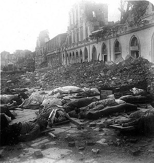 1908 Messina earthquake - Victims' bodies lying outside badly damaged and destroyed buildings in Corso Vittorio Emanuele which fronts the port of Messina